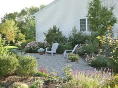 pea gravel garden - wish I could do my whole huge front yard this way!
