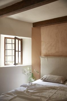 The master bedroom has a Mereson Pre-Washed Linen Headboard Cover from La Redout.