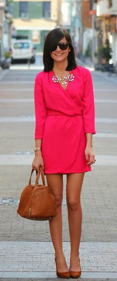 Stylish necklace and pink wrap mini dress