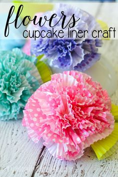 A fun little craft using cupcake liners, these flowers would make a great centerpiece for a spring brunch or to use as cute decor for a kids' room or craft room!