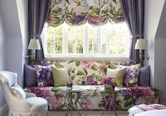 This window seat uses both draperies and shades to achieve its glamorous look. Voluminous purple curtains balance out the large floral print of the relaxed Roman shade. Home Curtains, Valance Curtains, Drapery Panels, Valances, Design Lounge, Sofa Design, Rideaux Design, Purple Curtains, Striped Curtains