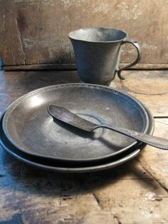 Pewter cup, and plates with old butter knife. HighButtonShoe farmhouse.