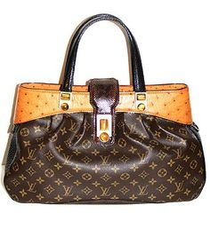 Oscar Waltz Bag. Pre-owned Louis Vuitton Runway Bag Limited Edition. FW 2005.  this limited edition bag is crafted of Monogram canvas and exotic leathers: natural ostrich, black lizard top handle and brown python trim. It is embellished with semi-precious tiger's eye cabochon and features a top zip and a front clasp. Pristine condition.  On sale at La Bourse du Luxe Pre Owned Louis Vuitton, Louis Vuitton Speedy Bag, Monogram Canvas, Python, Louis Vuitton Monogram, Exotic, Runway, Handle, Handbags