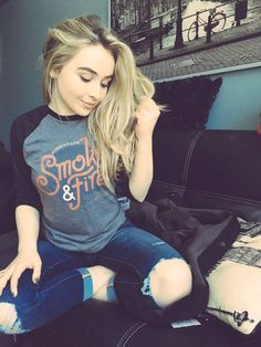 Sabrina Carpenter's super cute #SmokeAndFire tee is available here: http://www.revealproject.com/products/sabrina-carpenter-limited-edition-shirt ! Not only is it fashion-foward, but $10 of every purchase will go to the American Red Cross to help aid disaster relief projects all around the world.