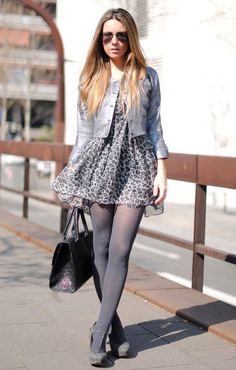 Sheer patterned pantyhose and mini skirt.