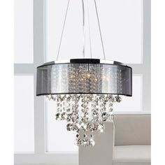 This stunning modern crystal chandelier makes an elegant highlight for any dining room or hall. Beautifully crafted and featuring a chrome finish with translucent black shade, this chandelier provides soft lighting and a stylish decorative accent. Chandelier Shades, Chandelier Lighting, Modern Chandelier, Modern Crystal Chandeliers, Capiz Chandelier, Chandelier Creative, Country Chandelier, Ceiling Fan, Ceiling Lights