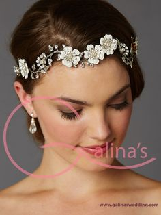 "Designer Hand-Enameled Blossom Headband Skilled artisans meticulously hand-enamel the ivory floral petals in this wedding day headpiece with silver leaves. Glass pearls and genuine crystals are painstakingly hand-wired to create this garden-of-flowers headband with slender satin ties. Can also be worn as a crown or tiara. This wholesale bridal stunner is a sight to behold! Design is 11 1/2"" across and 1 1/4"" h with 1/8"" w twin satin ribbons on each side. Made in USA.  Сheck out this and many…"