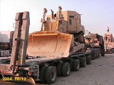 M1000 Heavy Equipment Trailer with Armored D-7 Bulldozer