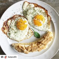 """@fedandfit officially made the worlds cutest breakfast this morning. I don't take saying that lightly either  # #Repost @fedandfit  Monday mornings got me like ! . What's on my simple breakfast plate: 2 sunny-side cast iron pastured eggs seasoned with """"Super Gyro"""" by #primalpalatespices and a sliced banana  smear of crunchy peanut butter (not Paleo but seems to work better for my body than almond butter)  a small drizzle of local honey  sprinkle of fine sea salt."""