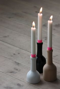 Ferm candleholders...with pink masking tape on them
