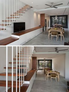The living room, dining room and kitchen in this home share the same space, with built-in cabinetry lining the wall under the stairs. It also continues into the kitchen, allowing for plenty of storage.