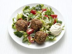 Food Network Magazine's easy recipe transforms an everyday salad into a hearty, satisfying plate with one key addition: falafel.