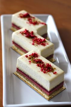 """The Astrid"" 1. White chocolate brownie, 2. Pistachio Sand, 3. Pistachio crunchy surprise, 4. Raspberry crémeux, 5. Raspberry Jelly, 6. Pistachio dacquoise, 7. Vanilla creme brulee, 8. White Chocolate Mousse, 9. White Chocolate Glaze. (Pinner´s note: I know it sounds frightening with so many ingredients and work, but wouldn´t be the most fantastic Christmas dessert we could prepare, with this combination of red and green?). NO RECIPE IN THE POST!"
