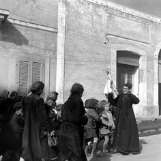 George Rodger—Time & Life Pictures/Getty Images Priest and children during the 1944 eruption of Mt. Vesuvius, Italy.