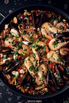 Seafood paella. You gotta love this dish. It's one of those dishes you can't wait to finish cooking so you can start eating it already.