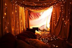 I am obsessed with twinkly lights... I would die to have this little fort.