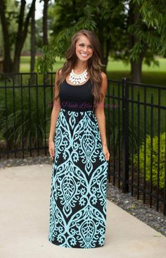 Conquer the fashion world in our maxi dress! Black and aqua hues in damask print are perfect for any adventure!