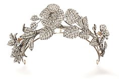A LATE 19TH CENTURY DIAMOND TIARA. Designed as an arched foliate spray with three flowerheads mounted en-tremblant set throughout with old-cut diamonds, dismantling to form three spray brooches or hair ornaments from which the three blossoms detach to form further hair ornaments, mounted in silver and gold