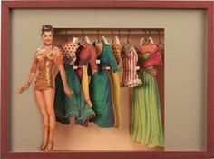 """Love the thought put into the frame design for this vintage paper doll and doll clothes! This crafty custom framer created a """"paper doll's closet"""" from what looks to be a dowel rod and matboard opening. Too clever! Did you every play with paper dolls as a child? Bet you wished you saved them for a project like this!"""