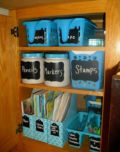 Organize this Family: Kid's Craft Cupboard- great way to use those large protein powder containers!
