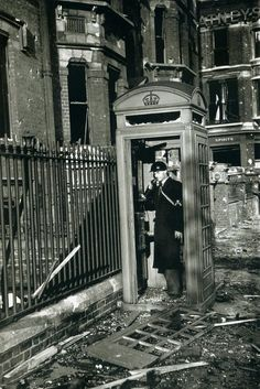 Air-raid Warden phones from shattered booth after a bombing raid. Life in London during The Blitz of World War II. By George Rodger miembro fundador de la Agencia Magnum. Air Raid, London History, British History, Uk History, History Channel, Vintage London, Old London, Blitz London, East London