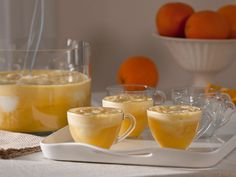 make creamsicle punch with:    Sunny D, whipped vodka, mango juice, vanilla sherbert and mandarin slices.