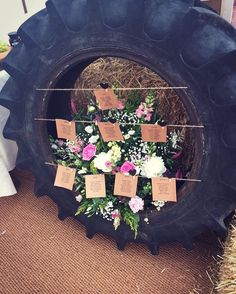 Wedding table plan in a tractor tyre