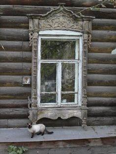 Carved wooden window frame of an old Tomsk house.