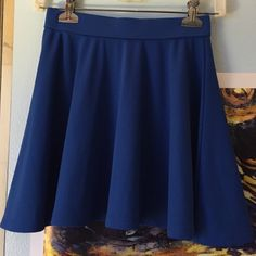 XXI Blue Skater Skirt Cute jersey like material, is courser than regular cotton. One very small grease spot on the front that can barely be seen. Forever 21 Skirts Circle & Skater