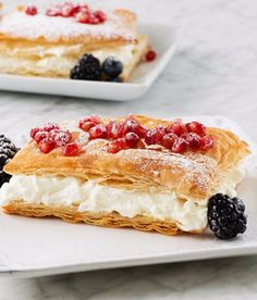Napoleons with Pomegranate or Berries - Delicate and flaky puff pastry with berry flavored pastry cream center. This is a delicious sweet treat for breakfast, brunch or dessert - especially when you add berry or almond liquor to the cream. This recipe is great for those who love fruit and would make a great treat for Mother's Day or a spring or summer get together.