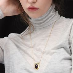 """""""Kisos""""Gold platted brass necklace, with an amethyst semi precious stone.  Ajustable lenght from 60 to 76 cm. Made in Velvetine's atelier in Paris  Made in France"""