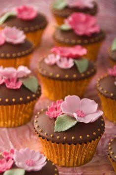 'Pink Blossom and Chocolate' wedding cupcakes    : Chocolate  fudge cake, Amedei Chuao chocolate buttercream,  chocolate fondant, handmade sugar flowers.    Price per cupcake  £7.50