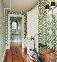 Green trellis wallpaper in Chloe Sevigny's apartment.