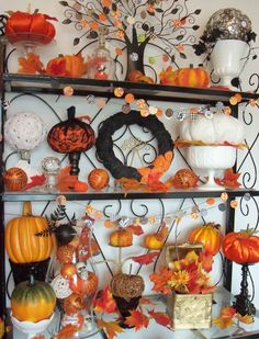 i love the different types of pumpkins on different candlestick bases.