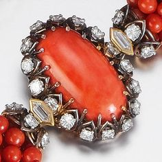 A coral and diamond necklace, by Cartier