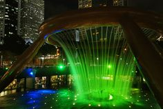 "Dazzling laser display at the Fountain of Wealth, Suntec City.  The Fountain of Wealth has been accorded the status of ""World's Largest Fountain"" in the 1998 edition of the Guinness Book of Records. It is symbolically the ring in the palm of the hand, Awesome Pic! Check out this amazing video:  http://www.empowernetwork.com/commissionloophole.php?id=michaelrochau"