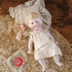 19C German Baby Bisque Doll With Lace Pillow