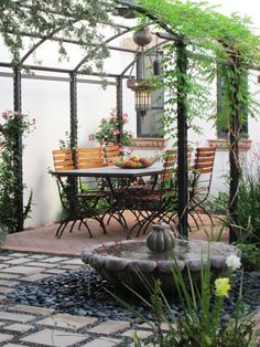 I want to create a space like this with a table, covering, permeable path and water feature.