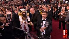 Sasha Baron Cohen as the Dictator. spiling Bisquick onto Ryan Seacrest Oscars 2012, Ryan Seacrest, Bisquick, Baron