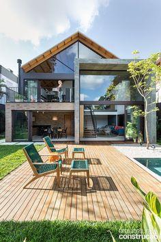 Casa só parece fechada: a área social é toda aberta para o jardim | Arquitetura e Construção