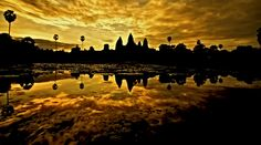 Viewing the temples at Angkor Wat, Cambodia in the early dawn. This photo taken by Steve Mackay, G Adventures