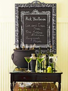 A drink station complete with beer-filled cauldron and clever signage is a great way to show off a Halloween wedding theme.