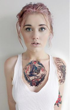 Amazing tattoo. Would love to be the type of person it would suit. On a sidebar, how realistic does the bird's face look!?