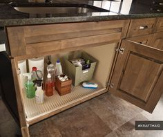The CoreGuard Sink Base is made of an engineered polymer and helps protect your investment by resisting damage and stains from minor leaks. (Rustic Alder cabinets in Husk Suede)