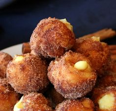 Snickerdoodle Poppers filled with Vanilla Pudding. Uses Grands biscuits, cinnamon sugar, & pudding.