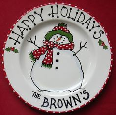 This 10 inch round jolly Snowman plate is the perfect holiday gift.  Hand Painted with lead free glazes and kiln fired making the image permanent and safe for use.   Text on rim can be customized by you.  Could also be used for a santas cookie plate with a childs name below. Please include text info in note to seller at checkout.    Please convo me if you would like a different size and I will make a custom listing for you.   Plates take 2 weeks to create plus shipping time. If you need a…