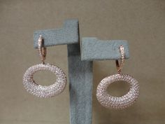 Rose gold and diamond oval earrings. Available at www.yanina-co.com, 800-780-3433.