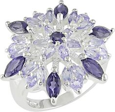 Click here for Ring Sizing ChartThis ring cannot be resizedSterling silver iolite and tanzanite ring