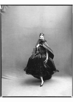 China Machado in Dior's airiest silk dress with lace ruffles worn with black taffeta stole Paris studio, August 1959 Richard Avedon
