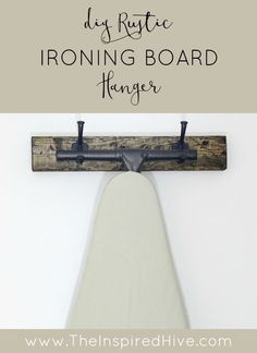 How to make a DIY distressed wooden ironing board hanger for your rustic laundry room